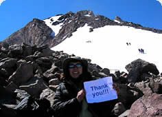 photo of a climber holding a sign that reads thank you