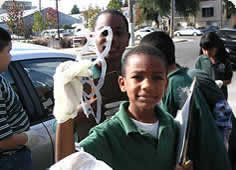 photo of children collecting refuse