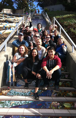photo of happy people congregating on a long decorated staircase outdoors